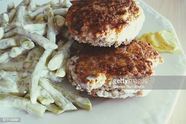 High Angle View Of Cutlets With Green Beans