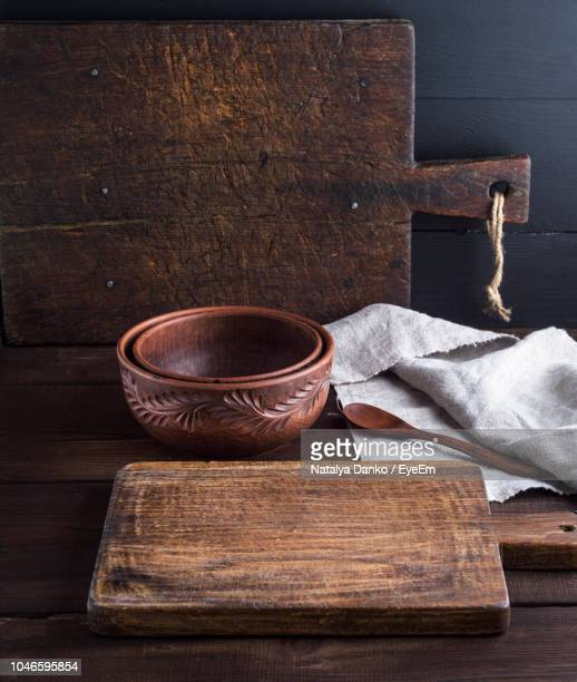 high angle view of cutting board with bowls and napkin on wooden table - cutting board stock pictures, royalty-free photos & images