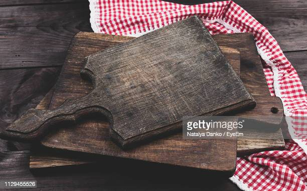 high angle view of cutting boards with napkin on wooden table - dish towel stock pictures, royalty-free photos & images