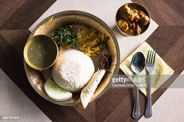 High Angle View Of Dahl And Rice Served In Plate On Table