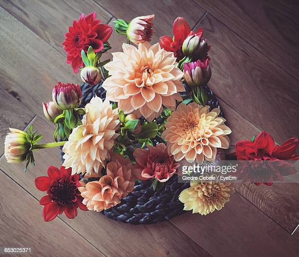 High Angle View Of Dahlias Over Wooden Table