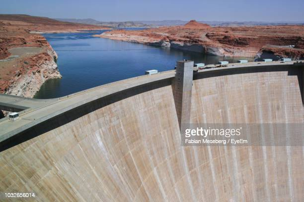 high angle view of dam and river - dam stock pictures, royalty-free photos & images