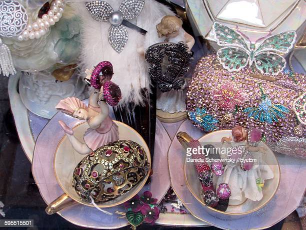 High Angle View Of Decorative Figurines At Shop Seen From Window