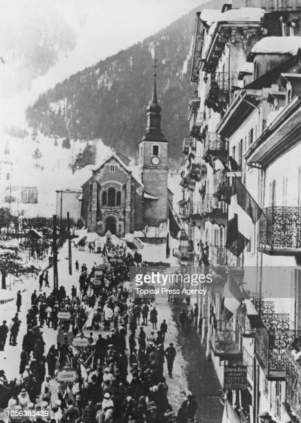 High angle view of delegates of the competing nations gathers before Saint-Michel Church and Hotel de Ville for the opening ceremony of the 1924...