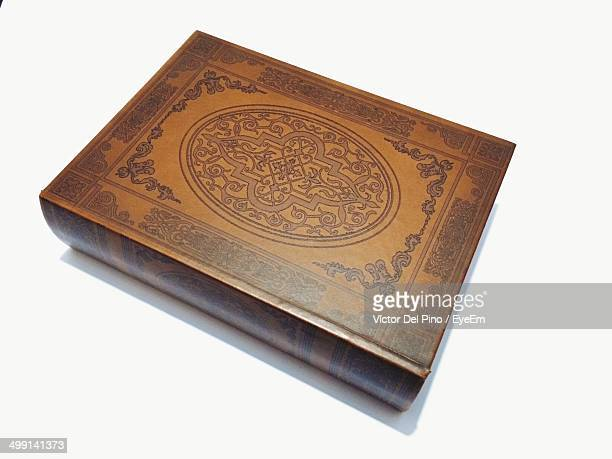 High angle view of designed hardcover book over white background