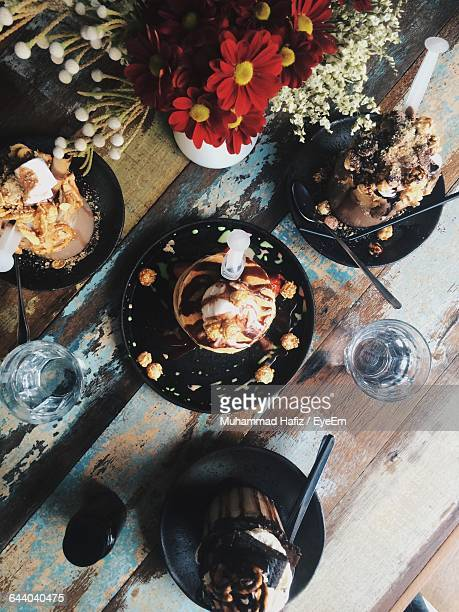 High Angle View Of Dessert Served On Table