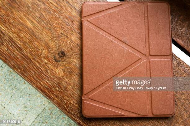 high angle view of digital tablet on table - phone cover stock pictures, royalty-free photos & images
