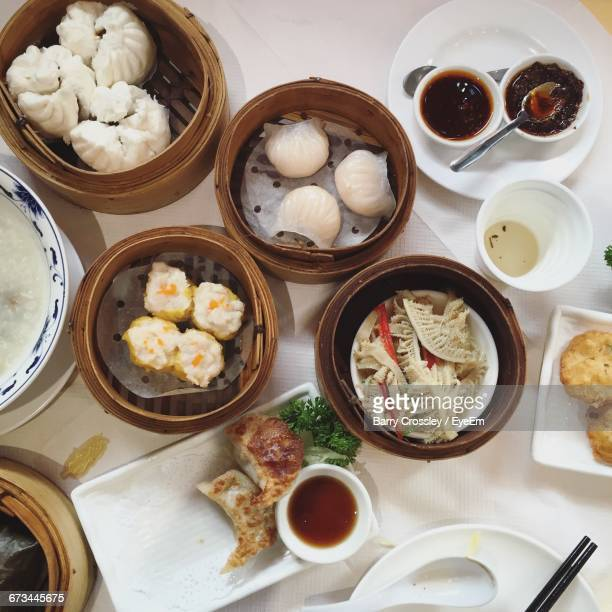 High Angle View Of Dim Sum Served On Table In Restaurant
