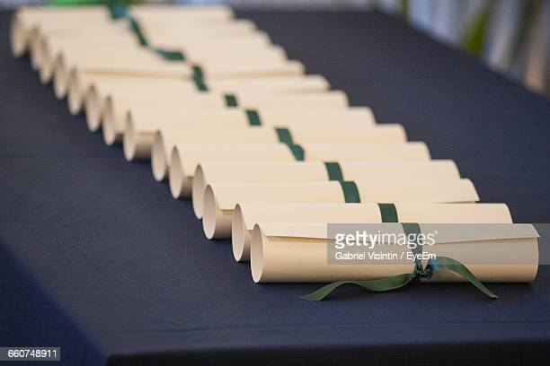 High Angle View Of Diplomas On Table