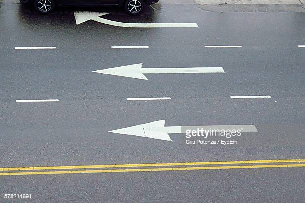 high angle view of directional sign on road - dividing line road marking stock pictures, royalty-free photos & images