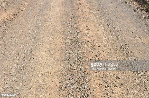 high angle view of dirt road - dirt track stock photos and pictures
