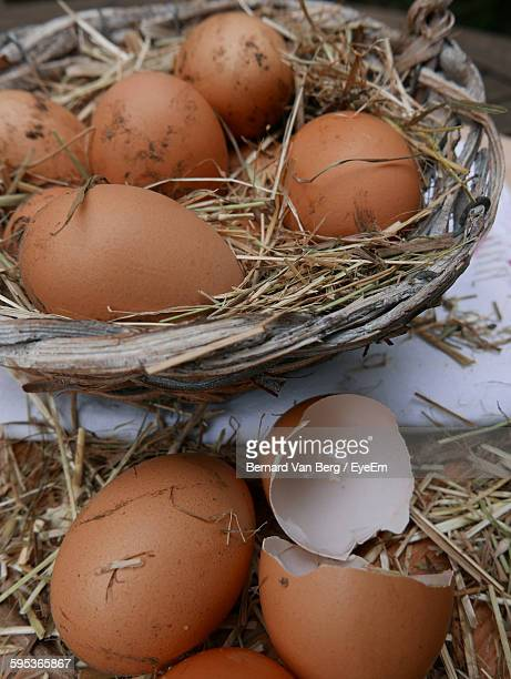 High Angle View Of Dirty Eggs In Wicker Basket