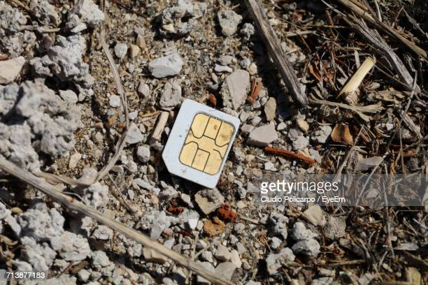 High Angle View Of Dirty Sim Card On Ground