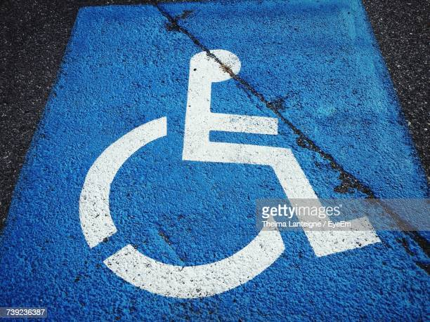 High Angle View Of Disabled Sign On Road