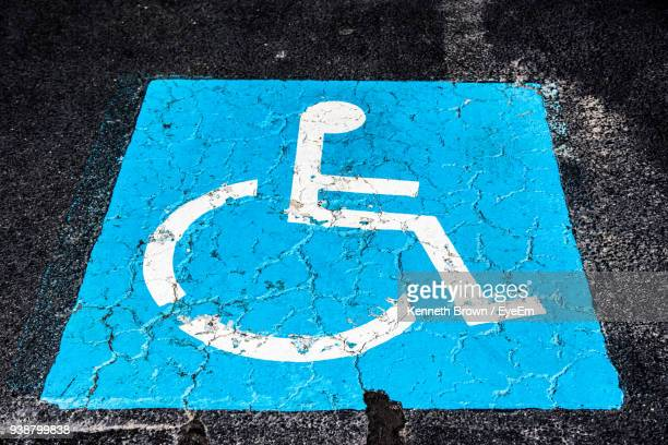high angle view of disabled sign on road - disabled sign stock photos and pictures