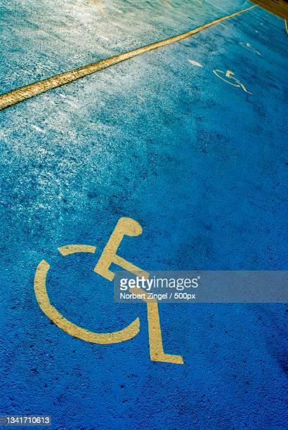 high angle view of disabled sign on wheelchair - norbert zingel stock-fotos und bilder