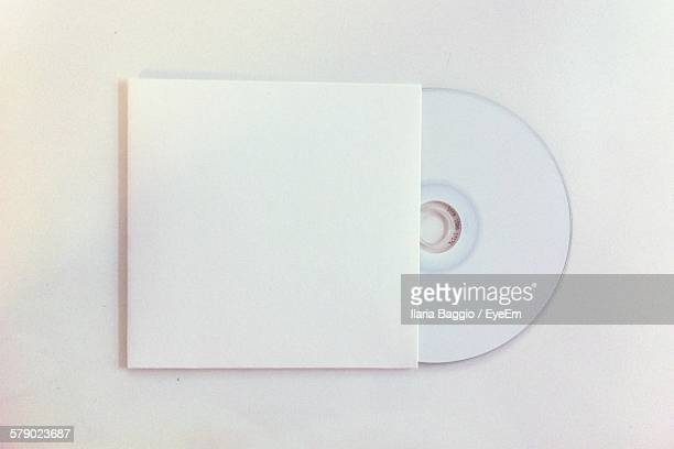 high angle view of disc on white background - compact disc stock pictures, royalty-free photos & images