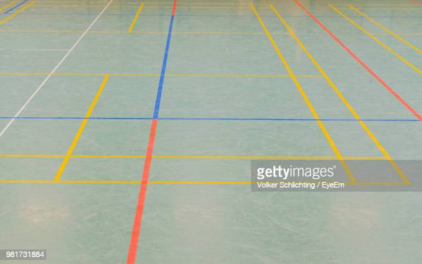 High Angle View Of Dividing Lines On Floor At Court