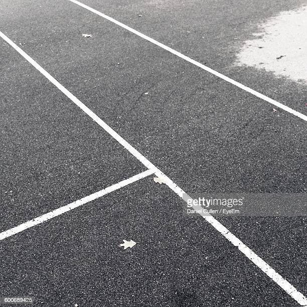 High Angle View Of Diving Lines At Tennis Court