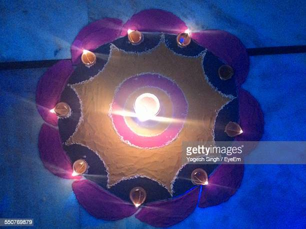 High Angle View Of Diyas Decorated On Rangoli During Diwali