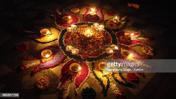 high angle view of diyas on rangoli during diwali - rangoli stock pictures, royalty-free photos & images