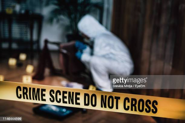 high angle view of do not enter sign in crime scene - 犯行現場 ストックフォトと画像