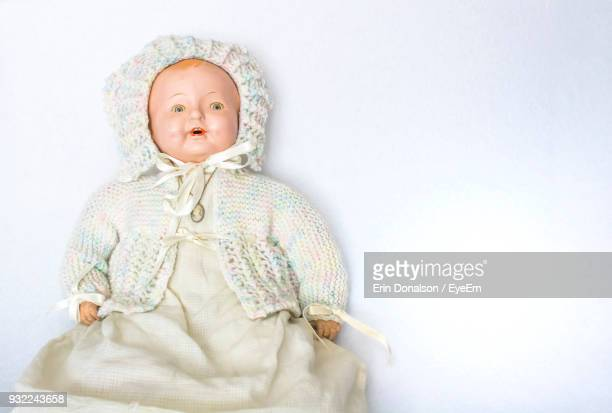 high angle view of doll on white background - pop stockfoto's en -beelden