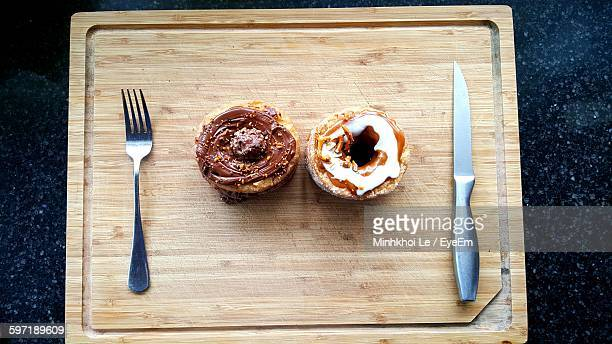 High Angle View Of Donuts On Cutting Board