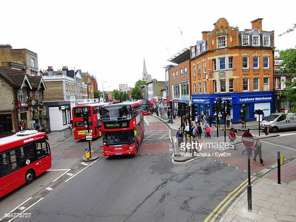 high angle view of double-decker buses at city street - road signal stock pictures, royalty-free photos & images