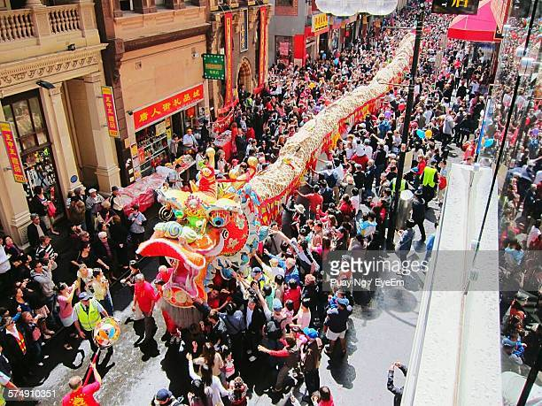 high angle view of dragon dancer on street during chinese new year - chinese dragon stock photos and pictures