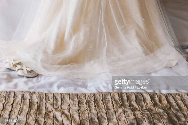high angle view of dress o bed at home - wedding dress stock pictures, royalty-free photos & images