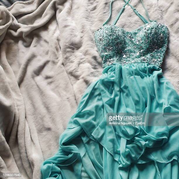high angle view of dress on bed - dress stock pictures, royalty-free photos & images
