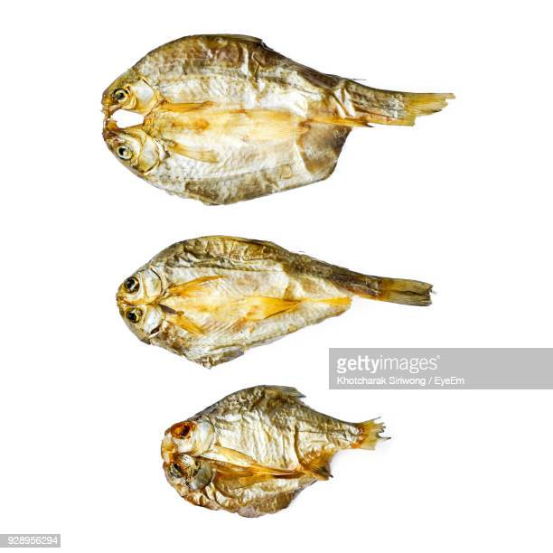High Angle View Of Dried Fish Over White Background