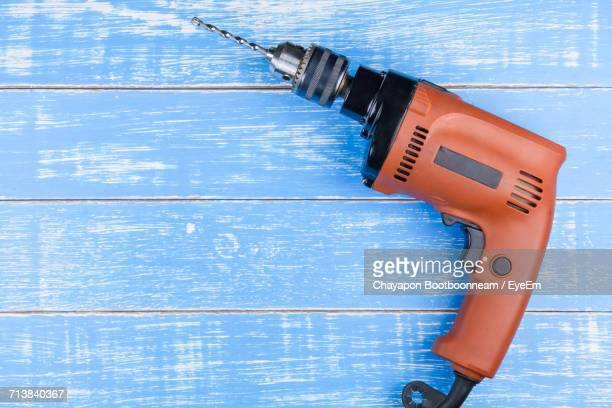 high angle view of drill on blue wooden table - drill stock pictures, royalty-free photos & images