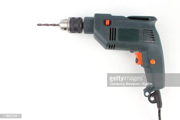 high angle view of drill on white background - taladro fotografías e imágenes de stock