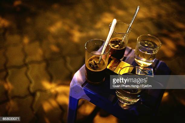 high angle view of drink in glasses on stool - hong quan stock pictures, royalty-free photos & images