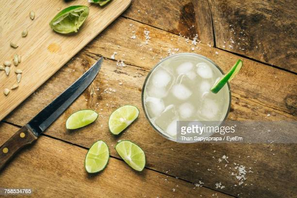 High Angle View Of Drink On Cutting Board