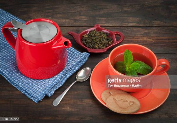 high angle view of drink on table - red kettle stock photos and pictures