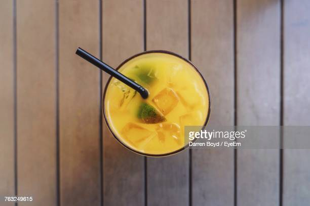 High Angle View Of Drink On Wooden Table