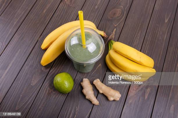 high angle view of drink with banana and juice on table - 率先 ストックフォトと画像