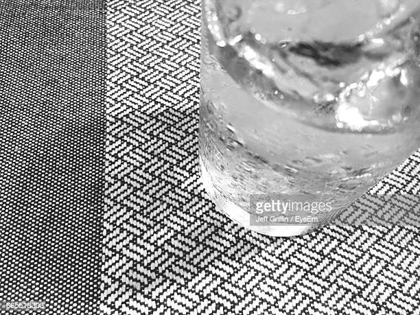 High Angle View Of Drinking Water In Glass At Table