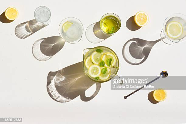 high angle view of drinks in glass on table during sunny day - 息抜き ストックフォトと画像