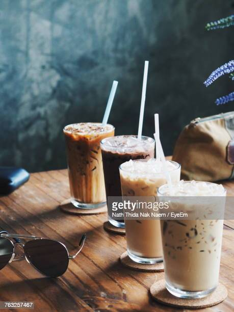 high angle view of drinks in glass on table - iced coffee stock pictures, royalty-free photos & images