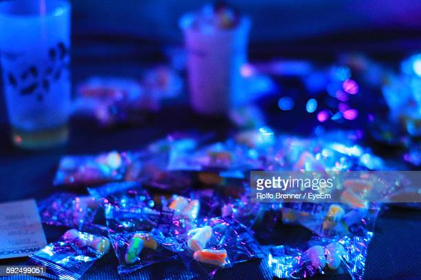 High Angle View Of Drugs On Table In Nightclub