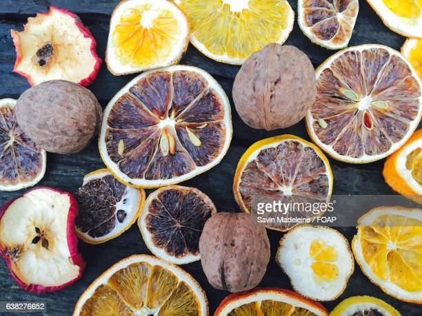 High angle view of dry orange and apple
