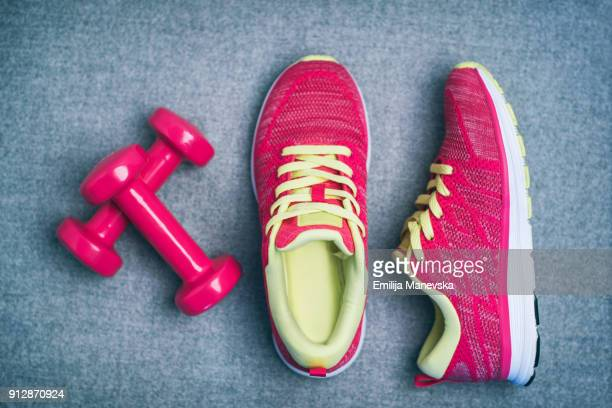 high angle view of dumbbell and sport shoes - sports clothing stock pictures, royalty-free photos & images
