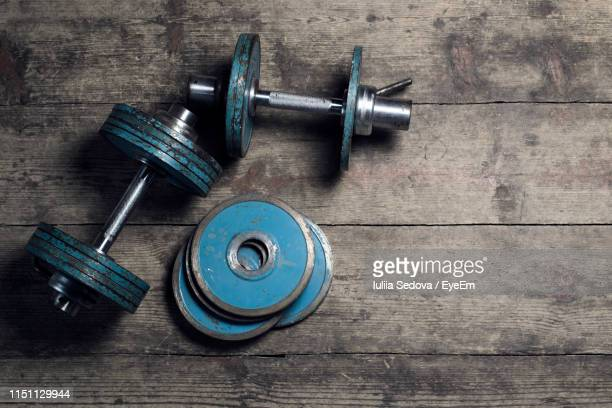 high angle view of dumbbells on table - sports equipment stock pictures, royalty-free photos & images