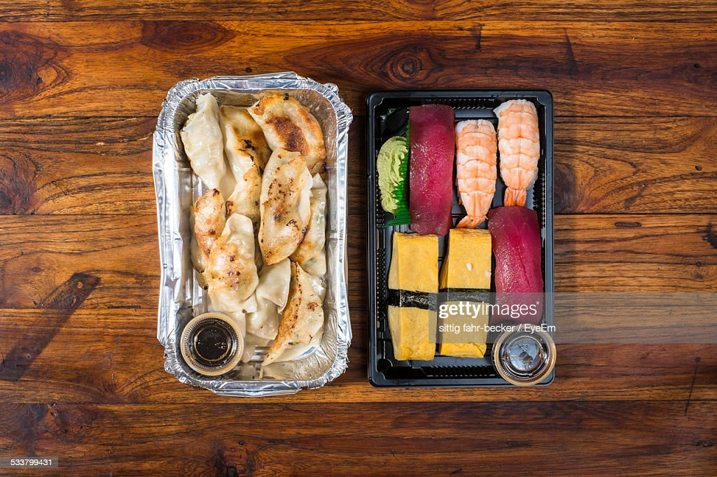 High Angle View Of Dumplings Food And Salmon Sushi On Table : Foto stock
