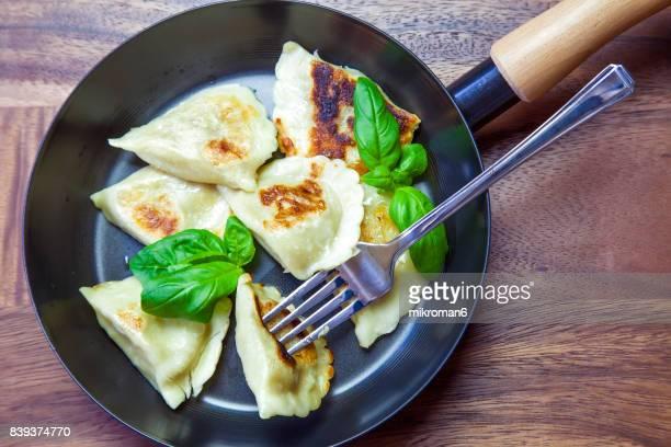 High Angle View Of Dumplings On  frying pan (Polish pierogies)