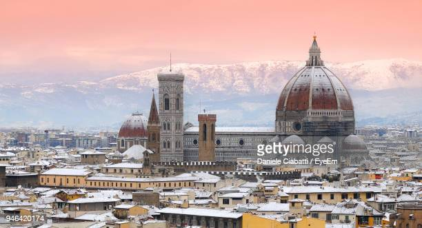 high angle view of duomo santa maria del fiore in city during winter - duomo santa maria del fiore stock pictures, royalty-free photos & images